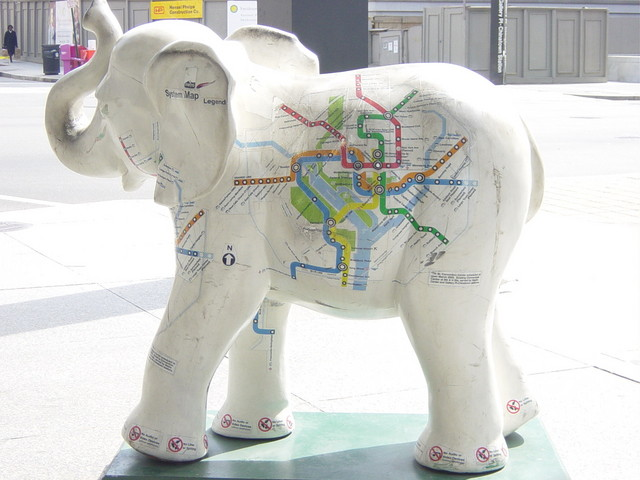 Elephant with a Metro map in front of the MLK library.